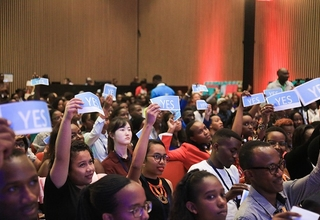 Photo: Young people respond to questions to causes of teenage pregnancy during health session at YCA summit