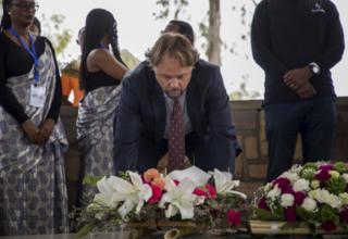 UNFPA Representative, Mark Bryan Schreiner, lays wreath at Ntarama Genocide memorial site