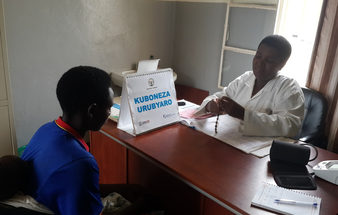 Photo: A Congolese refugee at a health facility receives family planning information and services from a nurse in Mugombwa Camp.