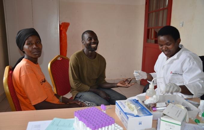 Uwamwiza Victoria and her husband Iyiragiye Jeremie test for HIV/AIDS before pregnancy test with help of Midwife Nyirarukundo Jeanne