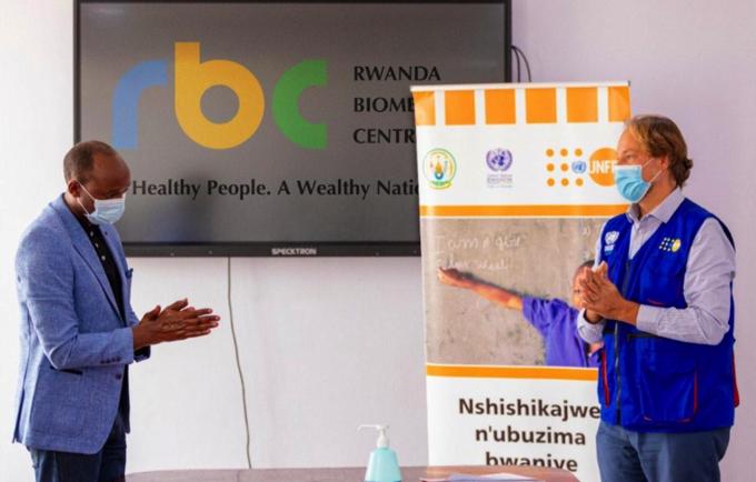Dr Sabin Nsanzimana RBC Director General with Mark Bryan Schreiner, UNFPA Representative at the PPE handover event.