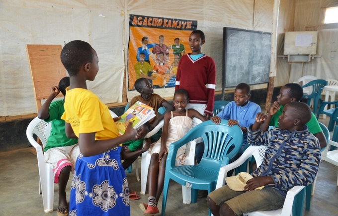 Children aged 10 – 13 in a discussion to share what they've learnt after SRH session with a Midwife