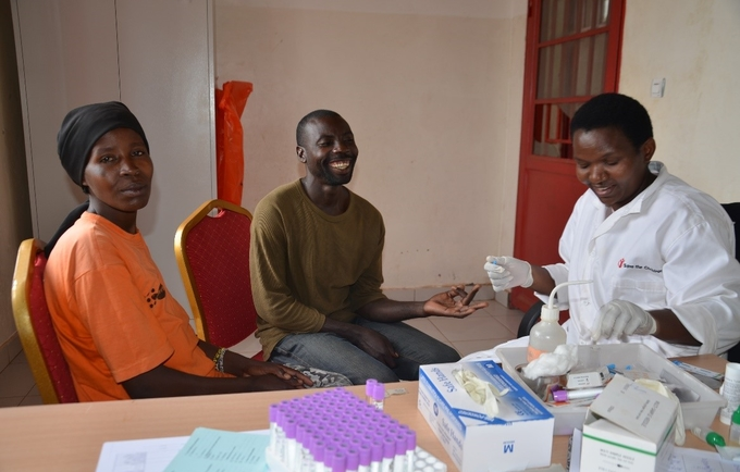 Uwamwiza Victoria and her husband Iyiragiye Jeremie test for HIV/AIDS before pregnancy test with help of Midwife Nyirarukundo Jeanne