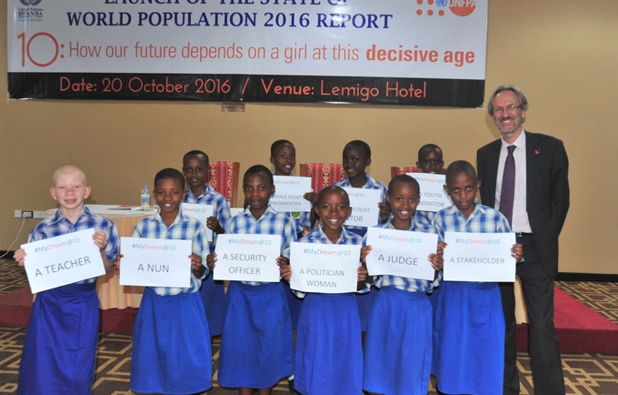 10-year old girls show their dreams during an interactive session at the launch of the State of the World Population report.